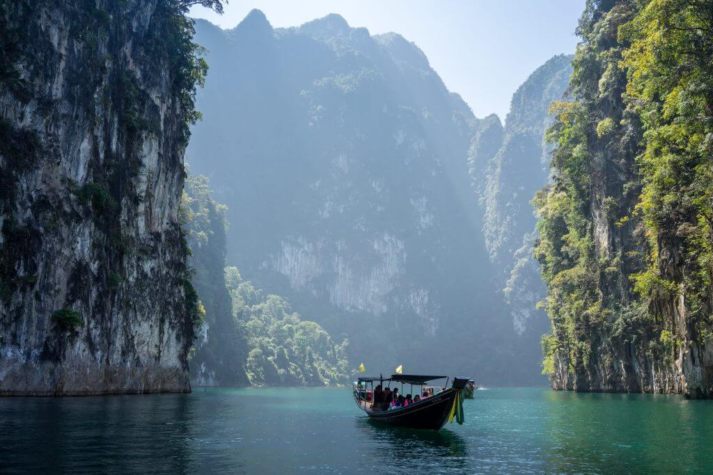 Thailand coast with cliffs and a boat